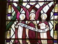"A portion of the Littlewood window showing angels with the inscription ""Holy, holy, holy is the Lord..."""