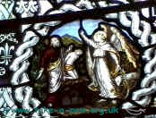 Small part of the St Thomas window giving a cameo depiction of Abraham preparing to slay Isaac.